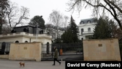 A man walks his dog past the Russian Embassy in Prague on Pod Kastany Square, which could be officially renamed on February 27 -- the fifth anniversary of Boris Nemtsov's killing. (file photo)