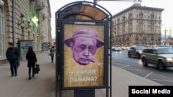 """Russia – A poster depicting Russian President Vladimir Putin and reading """"Which Panama?"""" at a bus stop in Moscow. 06Apr2016"""