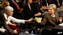 U.S. Secretary of State-designate and Senator Hillary Clinton (right) during her confirmation hearing