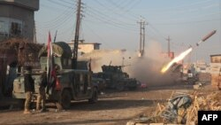 Iraqi forces launch a rocket in Mosul's eastern Al-Intisar neighborhood late last week. Officials say it could be months before government forces are able to completely retake the country's second-largest city from Islamic State militants.