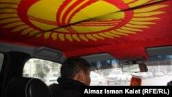 Сүрөттө: Бишкектеги такси айдоочусу
