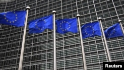 Belgium -- EU flags fly in front of the European Commission headquarters in Brussels, 12Oct2012