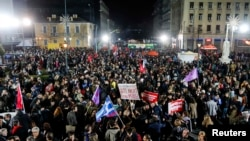 Сторонники СИРИЗА празднуют победу партии на парламентских выборах. Афины, 25 января 2015 года.