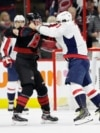The Washington Capitals' Alex Ovechkin (right) punches the Carolina Hurricanes' Andrei Svechnikov during the first period on April 15.