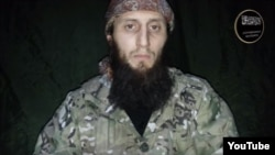 "A screengrab of Caucasus Islamist insurgent Mukhammad Abu Dudjana Gimrinsky who recently made a video appeal calling on ""sincere believers"" to join the jihad against ""unbelievers."""
