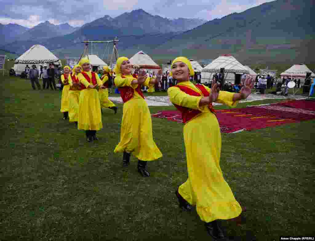 Horsemanship and the martial skills of the nomad are king at this tournament, but some gentler arts are also practiced. This group of school friends choreographed their own dance, which mixes traditional and modern moves.