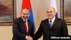 Kazakhstan -- Armenian PM Nikol Pashinian (L) and Russian PM Mikhail Mishustin. 31Jan., 2020
