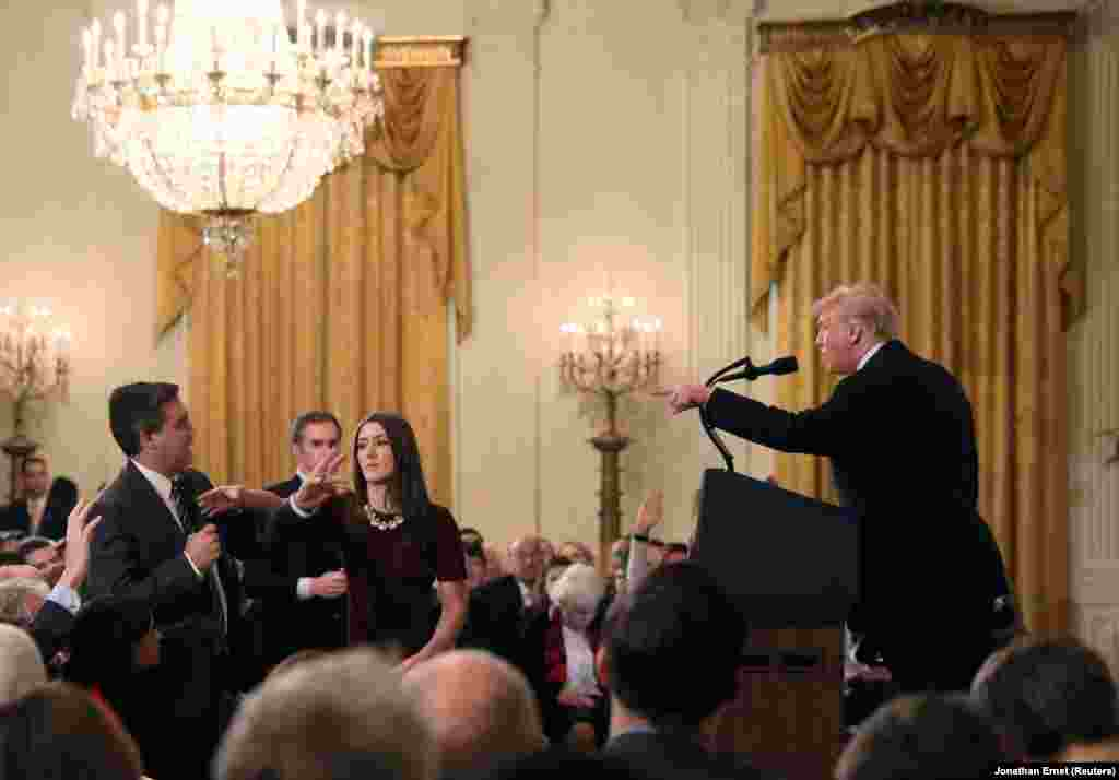 "A White House staff member tries to take away a microphone being held by CNN's Jim Acosta as he pointedly questioned U.S. President Donald Trump during a testy news conference following the November 6 midterm elections at the White House on November 7. Trump called Acosta a ""rude, terrible person."" Acosta's White House credentials were revoked over the incident. (Reuters/Jonathan Ernst)"