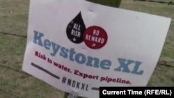 Транспарант на акции протеста против строительства нефтепровода Keystone XL в США. Январь 2015 года.
