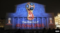 A light installation shows the official logotype of the 2018 FIFA World Cup during its unveiling ceremony at the Bolshoi Theater building in Moscow in October 2014.