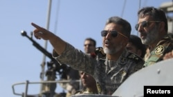 Iran -- Top naval commander, Admiral Habibollah Sayyari, points while standing on a naval ship during Velayat-90 war game on Sea of Oman near the Strait of Hormuz, 01Jan2012