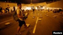 Гонконгтегі наразылық шеруіне қатысушылар. 14 қазан 2014 жыл.