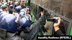 Police crackdown on opposition activists in Baku, in April 2011.