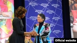 Tajikistan/USA, First Lady Michelle Obama Embraces 2014 IWOC Awardee Oinikhol Bobonazarova of Tajikistan,5February2014