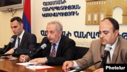 Armenia - Armen Yeghiazarian (C), acting director of the Center for Legislative Regulation, at a news conference in Yerevan, 11Jul2012.