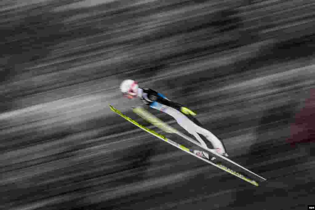 Ski jumper Evgeniy Klimov of Russia in action during a trial round of the fourth stage of the Four Hills Tournament at the FIS Ski Jumping World Cup event on the Paul Ausserleitner Hill in Bischofshofen, Austria. (epa/Christian Bruna)