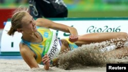 Ольга Рыпакова на состязаниях в тройном прыжке в Рио. 14 августа 2016 года.
