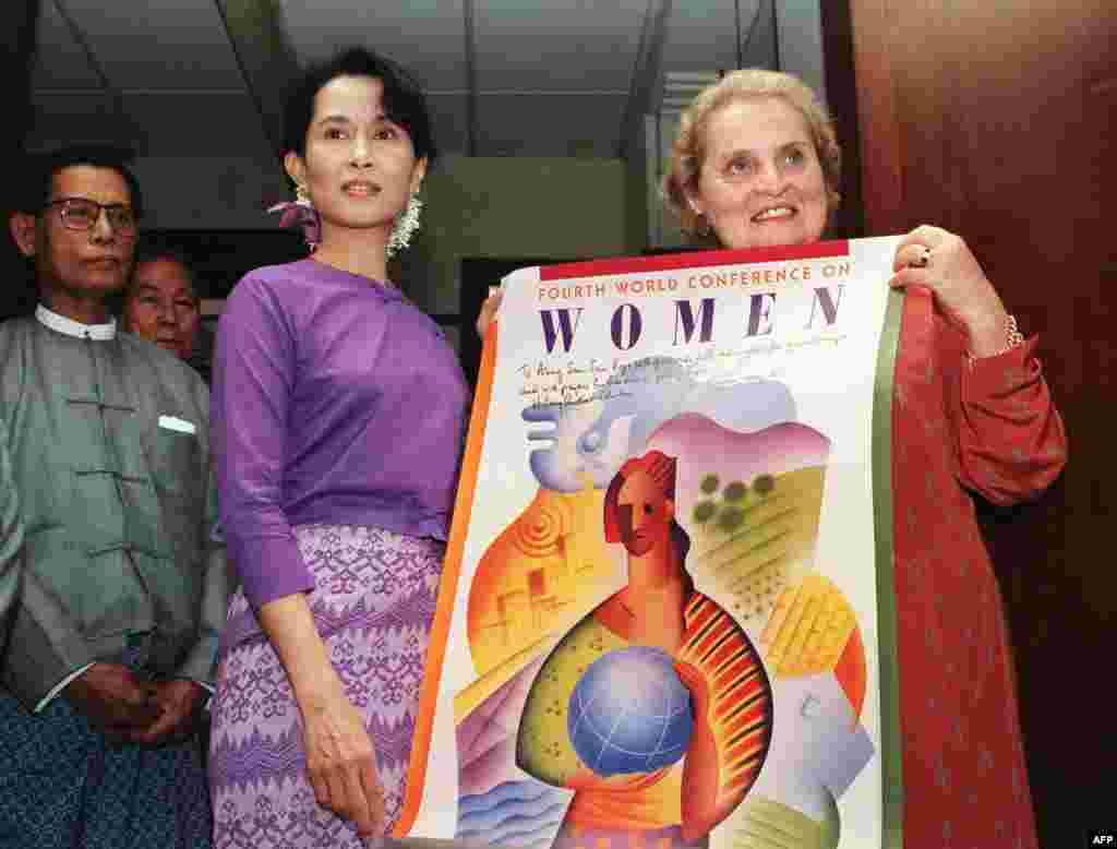 U.S. Ambassador to the United Nations Madeleine Albright presents a poster of the Fourth Women Conference during her meeting with Suu Kyi at her residence in Yangon on September 9, 1995.