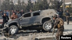 Afghan security forces inspect the site of a blast in Kabul, Afghanistan on December 28.