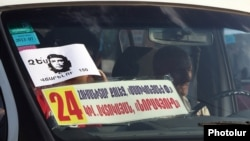 Armenia - A poster on the windscreen of a minibus urging Yerevan residents to defy higher fares, 24Jul2013.