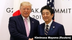 U.S. President Donald Trump (left) and Japanese Prime Minister Shinzo Abe (file photo)