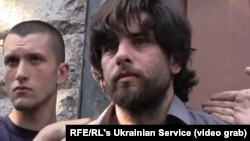 A screen grab of Rafael Lusvarghi being apprehended by a mob of Ukrainian nationalists on May 4.
