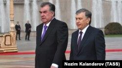 Uzbek President Shavkat Mirziyoev (right) is welcomed by Tajik President Emomali Rahmon in Dushanbe on March 9.