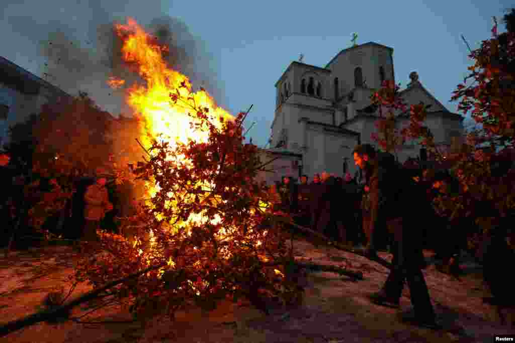 Serbs burn dried oak branches, which symbolizes the Yule log, on Orthodox Christmas Eve in front of the St. Sava temple in Belgrade on January 6. (Reuters/Marko Djurica)