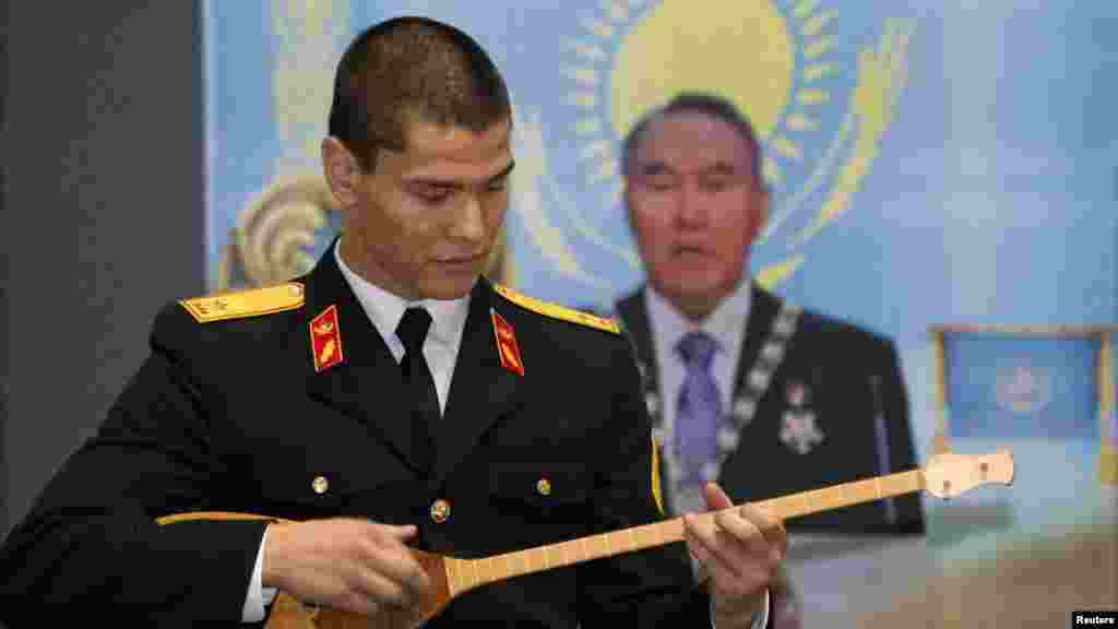 A cadet plays a dombra at the opening of an exhibition to mark the inaugural Day of the First President in the Central National Museum.