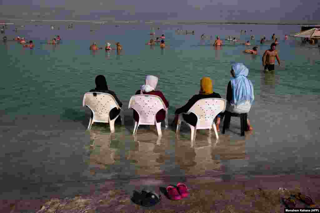 Tourists hang out at the resort of Neve Zohar on the Dead Sea in southern Israel. (AFP/Menahem Kahana)