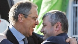 South Ossetian President Eduard Kokoity (right) embraces Russian Foreign Minister Sergei Lavrov in Tskhinvali on September 15.