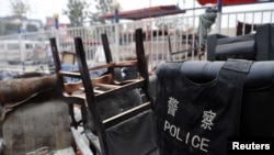 Destroyed furniture is stacked outside a police station after a July 18 clash in Hotan, in China's Xinjiang Uyghur Autonomous Region.