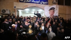 Supporters and family members of Jordanian pilot First Lieutenant Muath al-Kasasbeh gather following his reported killing in the Jordanian capital, Amman, late on February 3.