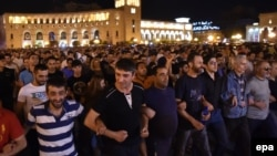 Supporters of the opposition hold a protest march in support of the gunmen in Yerevan on July 26.
