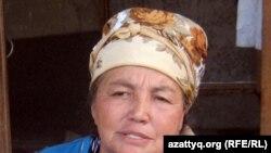 Жительница поселка Шанырак Базаркуль Толегенова. Алматы, 29 июня 2011 года.