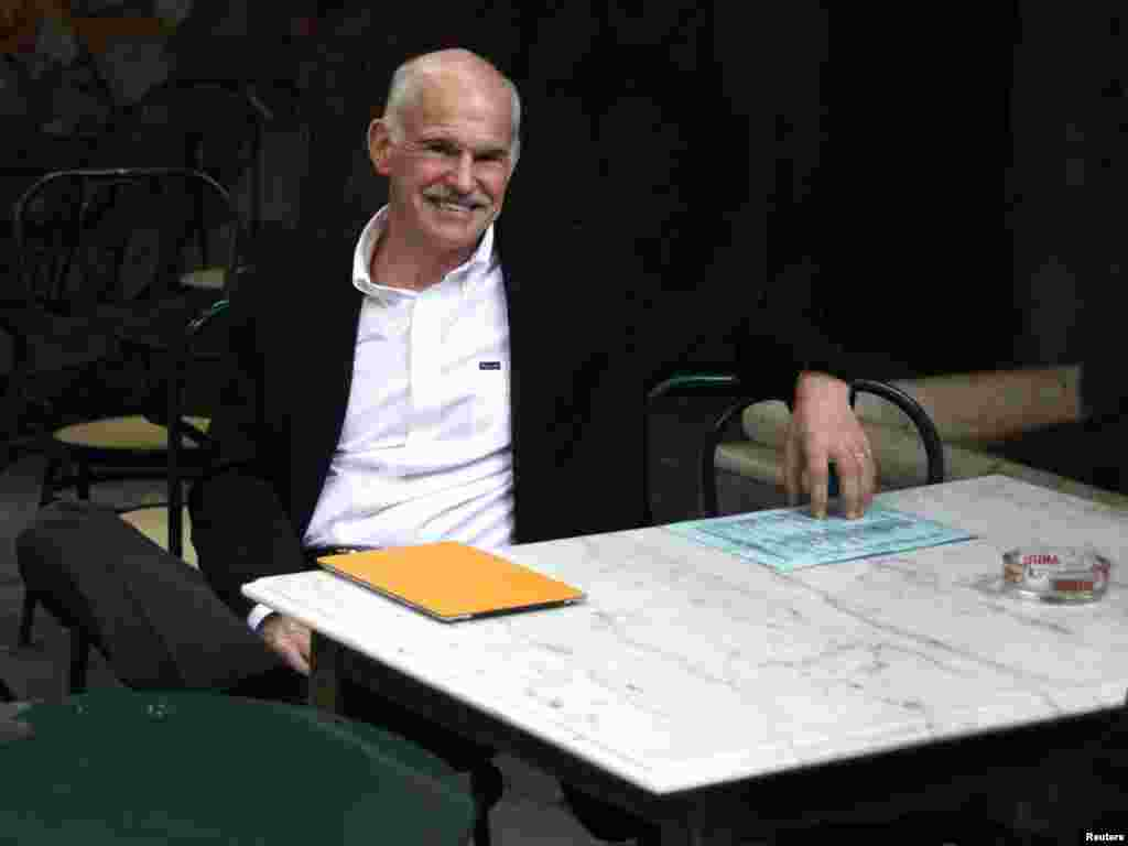 Former Greek Prime Minister George Papandreou sits in a cafeteria near the parliament in Athens amid crucial debt crisis talks. He has been replaced by former European Central Bank Vice President Lucas Papademos. (Photo for Reuters by Giorgos Kontarinis)