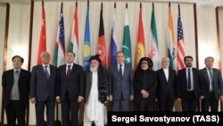 Russian Foreign Minister Sergei Lavrov (center) and members of Taliban delegation pose before the multilateral peace talks on Afghanistan in Moscow
