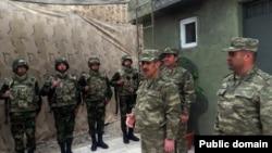 Azerbaijan - Azerbaijani Defense Minister Zakir Hasanov (C) visits the Karabakh frontline.