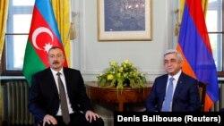 SWITZERLAND -- Azerbaijani President Ilham Aliyev (L) poses next to Armenian President Serzh Sarkisian at the opening of talks in Geneva, October 16, 2017