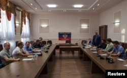 Переговоры с лидерами так называемой ДНР в Донецке при участии бывшего президента Украины Леонида Кучмы