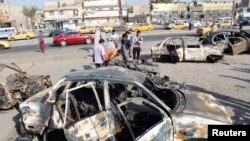 Pamje pas një sulmi të mëparshëm në lagjen Hurrija në Bagdad