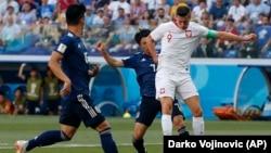 Збірна Японії (у синьому) програла в заключному матчі групового етапу Польщі, однак кваліфікувалася до плей-оф чемпіонату світу