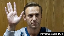 Aleksei Navalny gestures in a courtroom in Moscow in August.