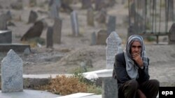 "A man at Kabul's graveyard for Afghan ""martyrs"" in the fight against Soviet troops in September 2006"