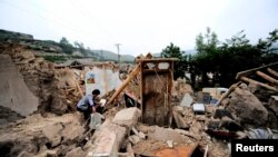 Після землетрусу, місто Дінсі, провінція Ґаньсу, 23 липня 2013 року