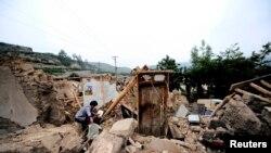 Разрушенный дом в округе Миньсянь