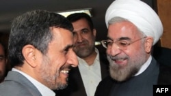 Then-President Mahmud Ahmadinejad (left), who consistently cast doubt on whether the Holocaust ever took place, greets President-elect Hassan Rohani in Tehran in mid-June.