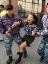 Kazakh law enforcement officers detain a woman during a protest rally by opposition supporters in Nur-Sultan on September 21. (RFE/RL / Orken Zhoyamergen)