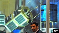 Iranian President Mahmud Ahmadinejad appeared at the unveiling ceremony of new Iranian satellite rockets on February 3, 2010.
