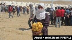 Сирійські біженці в таборі на території Курдського регіону Іраку, 17 серпня 2013 року
